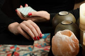 Hands of young woman with divination cards — Stock Photo