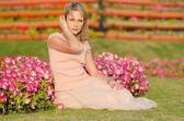 Young woman in Dubai Miracle Garden — Stock Photo
