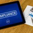 Stock Photo: Compliance on digital tablet