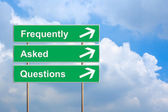 Frequently asked questions or FAQ on green road sign — Stock Photo