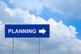 Financial planning on blue road sign — Foto de Stock