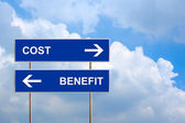 Cost and benefit on blue road sign — Stock Photo