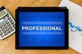 Professional word on digital tablet — Stock Photo