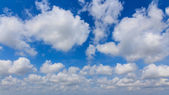 Blue sky with clouds wide screen — Stock Photo