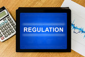 Regulation word on digital tablet — Stock Photo