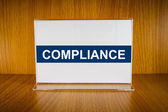 Compliance on Acrylic card holder — Stock Photo