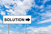 Solution on white road sign — Stock Photo