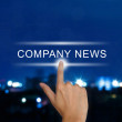 Hand pushing company news button on touch screen — Stock Photo #48796799