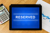 Reserved word on digital tablet — Stock Photo