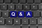 Q&A or Questions and answers word on keyboard — Stock Photo
