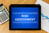 Risk assessment word on digital tablet — Photo