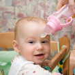 Baby and bottle — Stock Photo