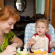 Mother and baby eating — Stock Photo