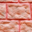Painted red brick wall as a background image — Stock Photo #31407927