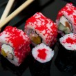 Seafood. Traditional sushi and rolls on the  dish. — Stock Photo