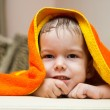 Baby after the bath under towel — Stock Photo