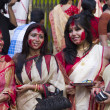 Stock Photo: Hindu women play with vermilion during durgpuja