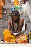 Indian Sadhu reading news paper — Stock Photo