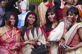 Hindu women play with vermilion during durga puja — Stock Photo