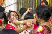 A Women devotee apply sindhoor to another's chin — Stock Photo