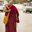 old monk in streets of leh — Stock Photo