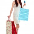 Happy red haired woman carying shopping bags — Stock Photo #30410895
