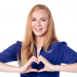 Woman making a heart gesture — Stock Photo
