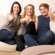 Three enthusiastic teenagers giving a thumbs up — Stock Photo #39868421