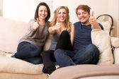 Three enthusiastic teenagers giving a thumbs up — Stock Photo