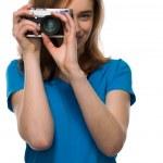 Постер, плакат: Young woman taking a photograph