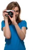 Young woman taking a photograph — Stock Photo