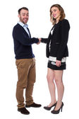 Smiling man and woman shaking hands on a deal — Stock Photo
