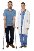 Man on Crutches and Lady Doctor Standing — Stock Photo