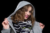 Happy flirtatious woman in a hooded jacket — Stock Photo