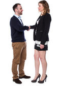 Young man and an attractive woman shaking hands — Stock Photo