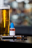 Beer, e-juice and personal vaporizer — Stock Photo
