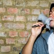 Young man enjoying a satisfying e-cigarette — Stock Photo #49386135