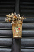 Wooden and painted plant pot — Stock Photo