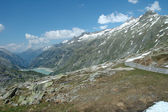 Valley and road in Alps — Stock Photo