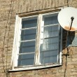 Old white wooden window and satellite dish — Stock Photo #43445603