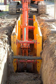 Digger shovel inside ditch — Stockfoto