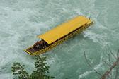 Boat under waterfall — Stock Photo
