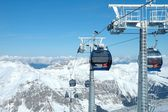 Peaks and ski lifts — Stock Photo