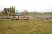 Fire brigade exercises on river bank — Stock Photo