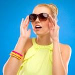 Pretty girl holding sunglasses. — Stock Photo #30459587