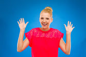 Happy woman looking surprised with hands up. — Stock Photo