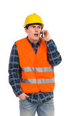 Shocked engineer using cell phone. — Foto Stock