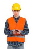 Engineer using smart phone. — Stock Photo