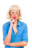 Blond woman with fake eyes sticking out tongue — Stock Photo