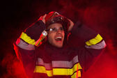 Shocked firefighter in action — Stock Photo